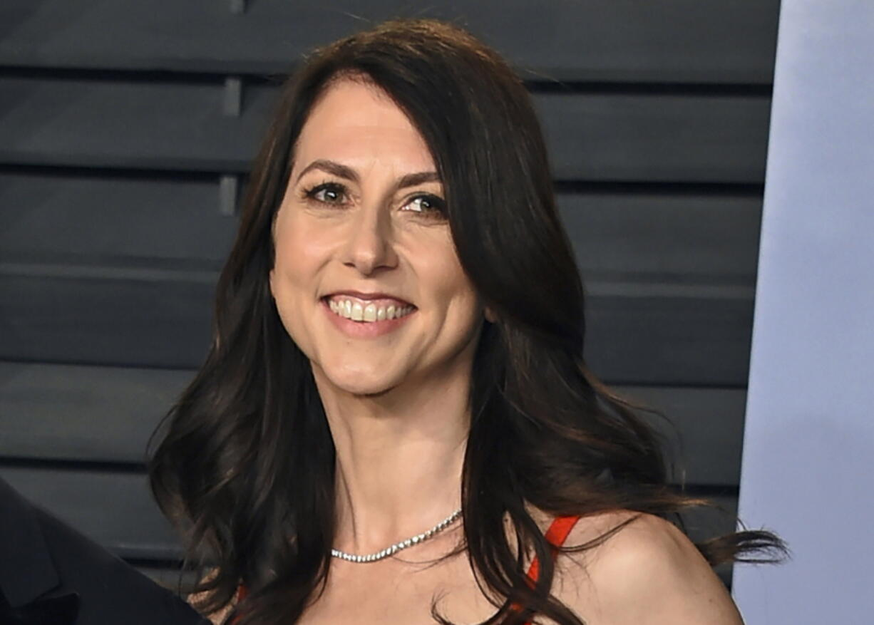 FILE - In this March 4, 2018, file photo, then-MacKenzie Bezos arrives at the Vanity Fair Oscar Party in Beverly Hills, Calif. Galvanized by the racial justice protests and the coronavirus pandemic, charitable giving in the United States reached a record $471 billion in 2020, according to a Giving USA report released Tuesday, June 15, 2021. MacKenzie Scott stormed the philanthropy world in 2020 with $5.7 billion in unrestricted donations to hundreds of charities. The seven- and eight-figure gifts were the largest many had ever received.