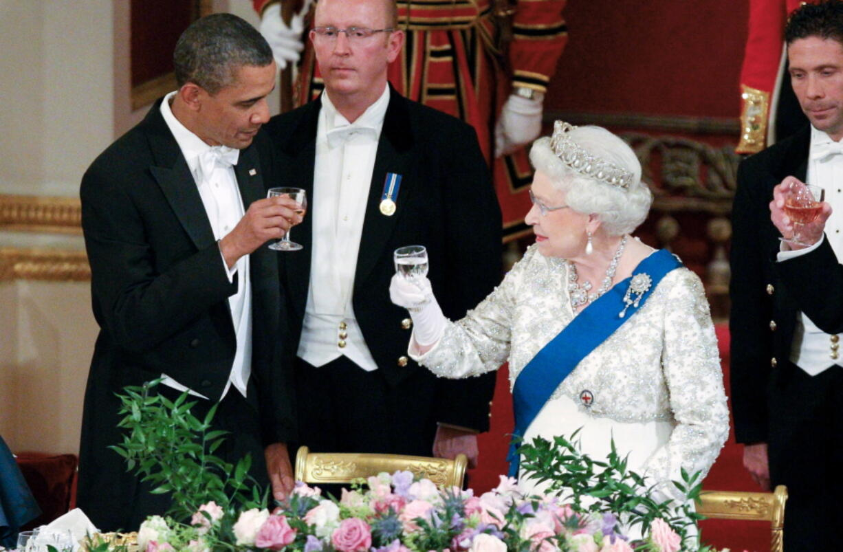 FILE - In this May 24, 2011, file photo Queen Elizabeth II, and U.S. President Barack Obama attend a state banquet in Buckingham Palace, London.