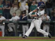 Seattle Mariners' Kyle Seager hits a single to drive in the winning run in the ninth inning of the team's baseball game against the Tampa Bay Rays, Thursday, June 17, 2021, in Seattle. The Mariners won 6-5. (AP Photo/Ted S.