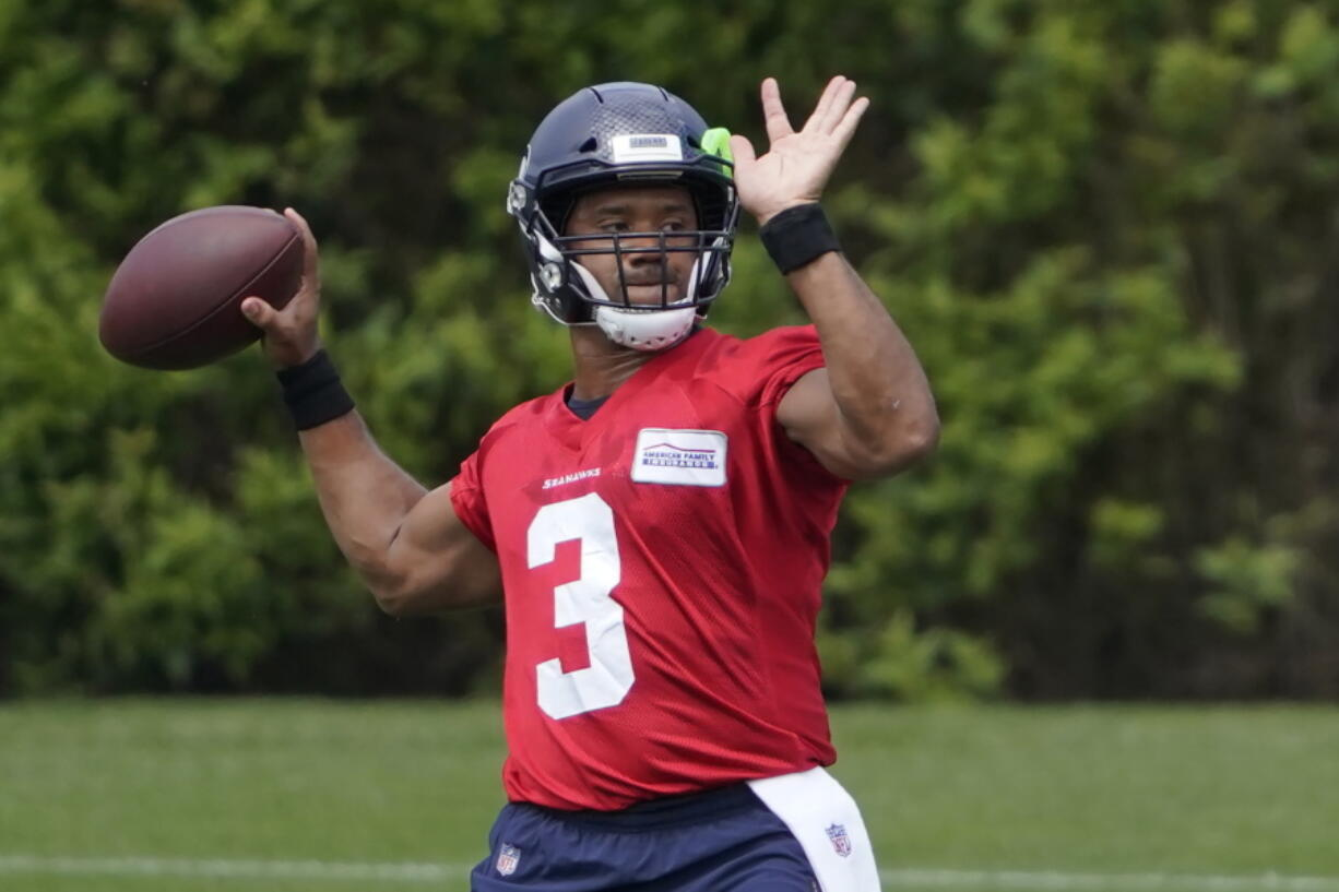 Russell Wilson says watching Tom Brady lead the Bucs to a Super Bowl win caused frustration to reach a bowling point. (Ted S.
