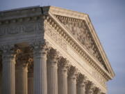 FILE - In this Nov. 5, 2020, file photo the Supreme Court is seen in Washington. With abortion and guns already on the agenda, the conservative-dominated Supreme Court is considering adding a third blockbuster issue -- whether to ban consideration of race in college admissions.  (AP Photo/J.