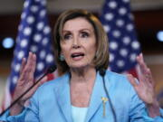 Speaker of the House Nancy Pelosi, D-Calif., talks to reporters just after the Supreme Court dismissed a challenge to the Obama-era health care law, at the Capitol in Washington, Thursday, June 17, 2021. (AP Photo/J.