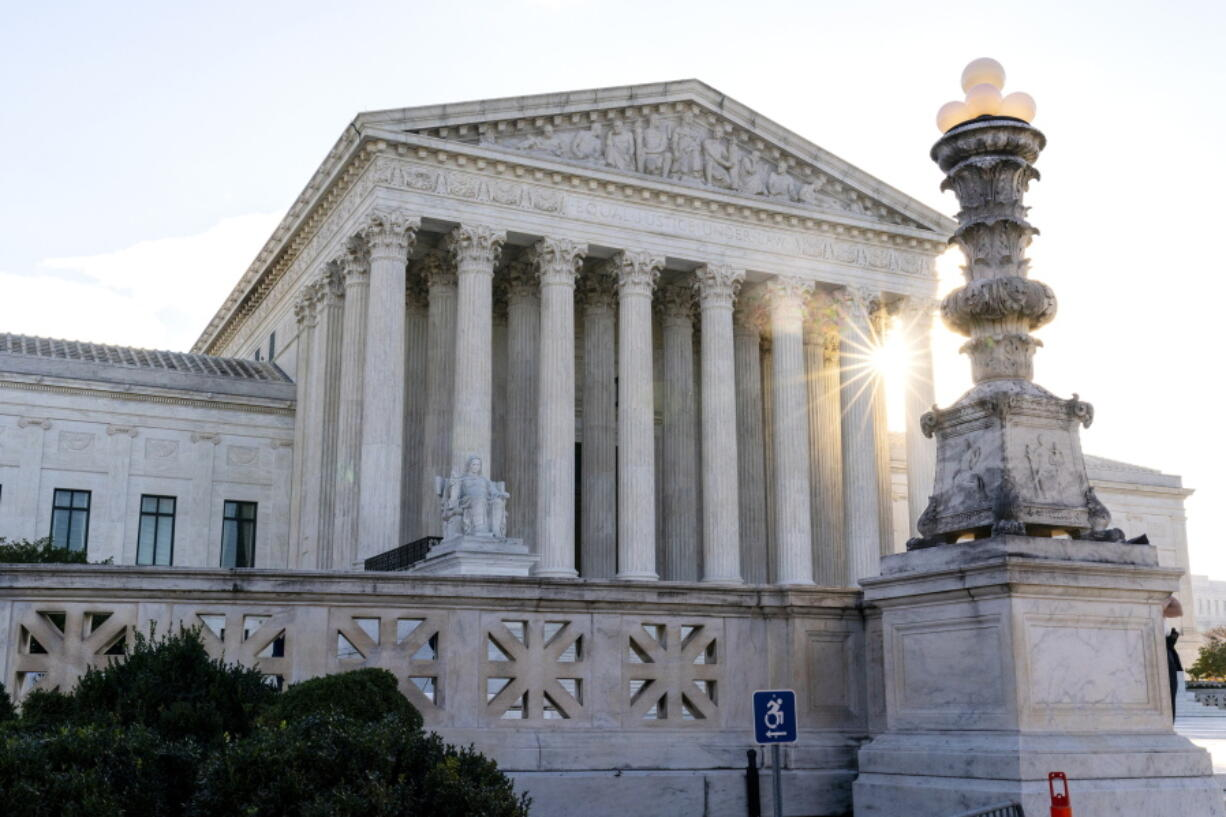 FILE - In this Nov. 10, 2020, file photo the sun rises behind the U.S. Supreme Court in Washington.