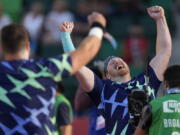 Ryan Crouser celebrates after setting a world record during the finals of men's shot put at the U.S. Olympic Track and Field Trials Friday, June 18, 2021, in Eugene, Ore.