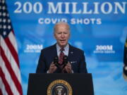 FILE - In this April 21, 2021, file photo, President Joe Biden speaks about COVID-19 vaccinations at the White House, in Washington. In April, the Biden administration announced plans to share millions of vaccine doses with the world by the end of June.