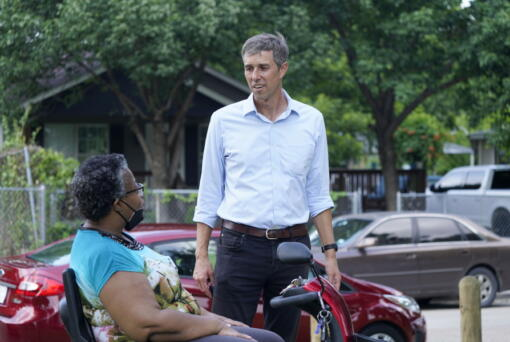 Beto O'Rourke, right, speaks with Stephanie Hanson before a canvassing drive by the Texas Organizing Project in West Dallas Wednesday, June 9, 2021. The former congressman and senatorial candidate is driving an effort to gather voter support to stop Texas' SB7 voting legislation. As politicians from Austin to Washington battle over how to run elections, many voters are disconnected from the fight. While both sides have a passionate base of voters intensely dialed in on the issue, a disengaged middle is baffled at the attention.