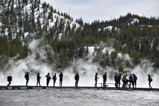 Visitors are seen at Grand Prismatic Spring in Yellowstone National Park, Wyo., on May 1. A study by federal and university researchers says average park temperatures in recent decades were likely the warmest of the last 800,000 years.