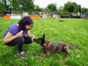 Amritha Mallikarjun trains with Lucy, a cancer-detecting dog, at the Penn Vet Working Dog Center in Philadelphia.