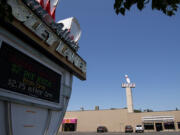 The Crosley Lanes sign flashes and spins on Tuesday in Vancouver. Owners Don and Rachel Allen plan to retire and sell the property to a developer who intends to build a five-story apartment complex on the site.