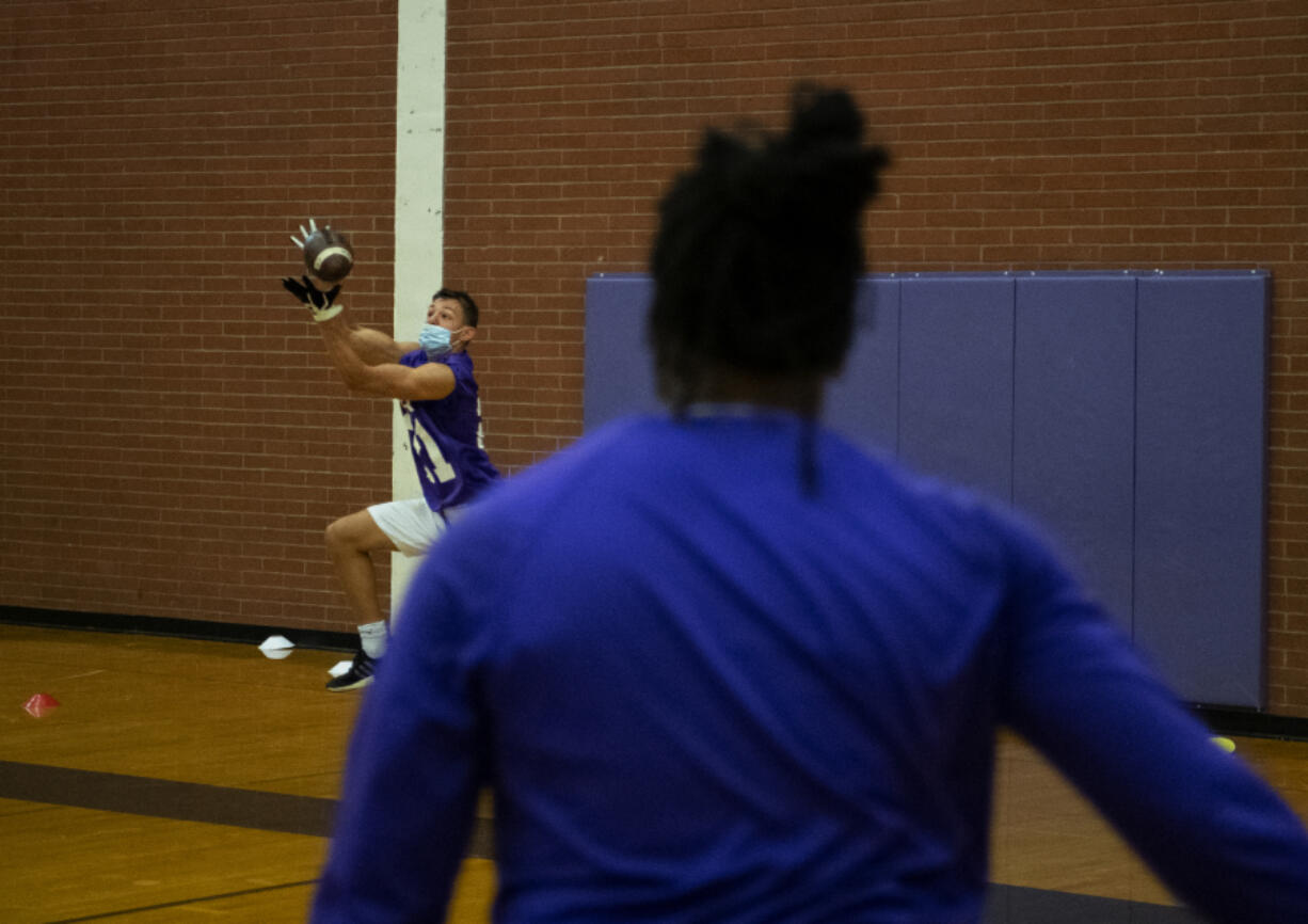 Columbia River football team?s receivers run through a drill on Tuesday, June 29, 2021, at Columbia River High School. As football teams ready for a return to normal this fall, coaches are adjusting to the current and everchanging restrictions, revised schedules and the effects of a season that ended just months ago.