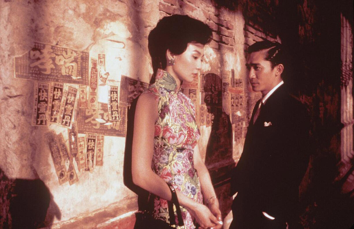 """Maggie Cheung, left, stars as Li-zhen and Tony Leung as Chow in the Wong Kar-Wai film, """"In The Mood For Love."""" (2000 USA Films/Online USA/Hulton Archive/Getty Images)"""