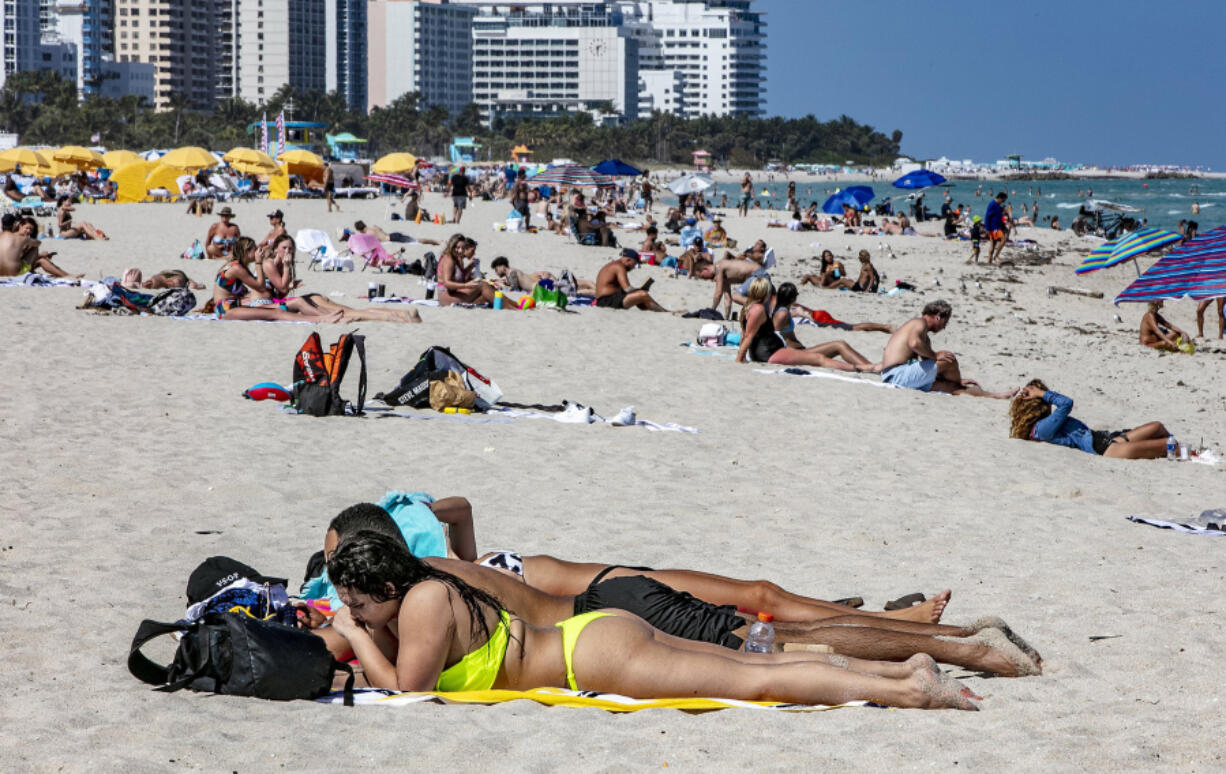 Beachgoers on South Beach on March 2, 2021. States who rely heavily on international tourists have been hit hard during the pandemic.