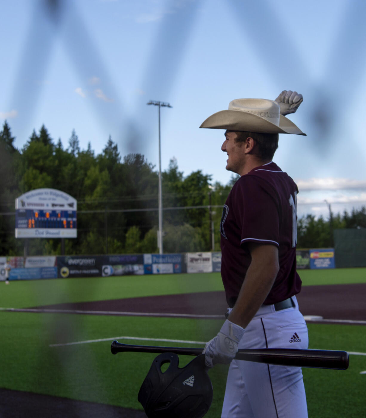 Ridgefield's Kody Darcy pretends to use a lasso while putting on a home run hat after clearing the center-field fence in the second inning in a West Coast League baseball game on Tuesday, June 8, 2021, at the Ridgefield Outdoor Recreation Complex. Ridgefield won 6-3 to improve to 4-0 on the season.