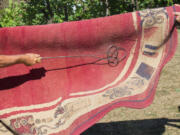 The old-fashioned method of rug beating is actually an effective tool for reducing indoor pollen and dust.