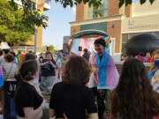 Alex Churchman takes part in a trans march and rally in Arkansas. The 13-year-old says he found support from Seattle-based Beloved Arise, an organization for queer youth of faith around the country and world, when he felt rejected by his church.
