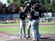 Coby Morales (28),  Caden Connor and Reece Hernandez congratulate John Peck (6)  after Peck hit a three-run home run in the top of the third inning of the Ridgefield Raptors' 5-2 win over Cowlitz Black Bears on Sunday, July 11, 2021 in Longview (Josh Kirshenbaum/Longview Daily News)