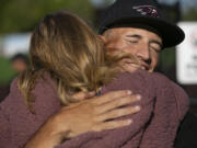 Eli Shubert, pitcher for the Ridgefield Raptors, hugs his mom Vicky Shubert after marrying Erin Thum in a short ceremony on the field before a game against the Port Angeles Lefties at Ridgefield Outdoor Recreation Complex on Wednesday, July 14, 2021.