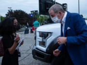 Allegra Blackwood, 13, interviews Bill Ford, executive chair of Ford Motor Co., at Ford World Headquarters in Dearborn, Michigan before the F-150 Lightning reveal on May 19, 2021.