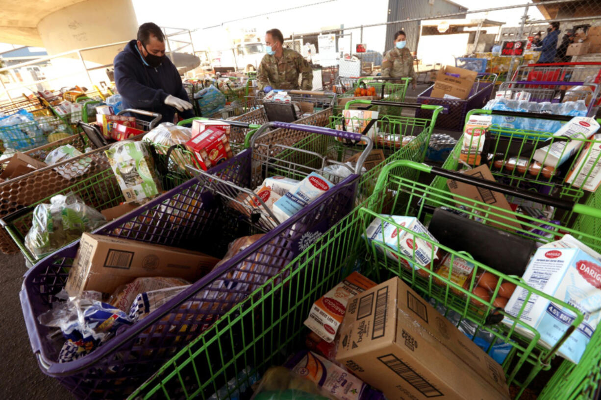 The Emergency Food Bank delivers food to needy families and individuals in Stockton, California, on Dec. 10, 2020.