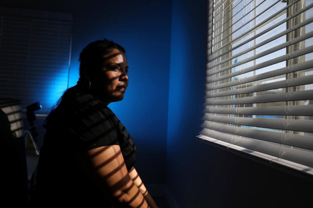 Areli, from Guatemala, came to the U.S. fleeing her father who she said sexually abused her and sold her to other men for sexual favors. She had enough and left for Guatemala after her mother died and her father came looking for her and her young daughter, photographed at her apartment on Wednesday, July 7, 2021 in Los Angeles, CA.