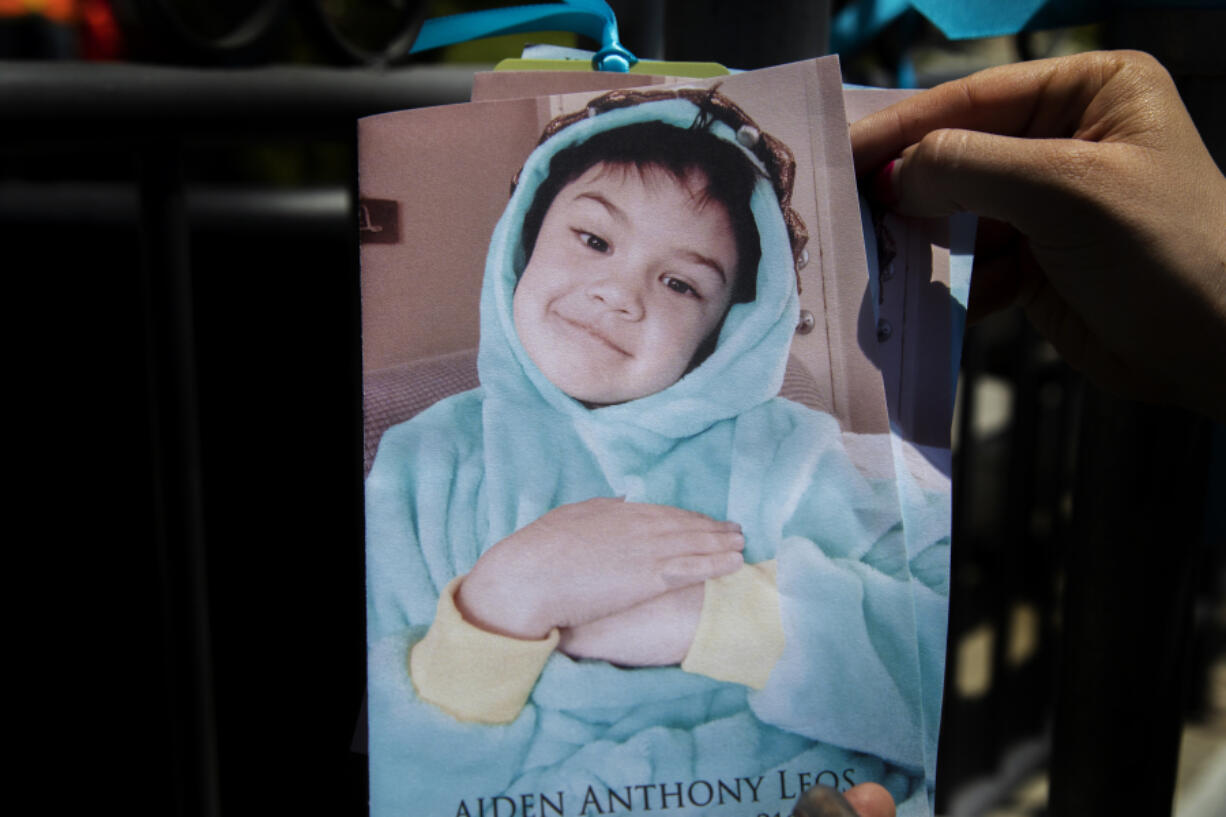 A photograph of 6-year-old Aiden Leos covers his memorial service program at his funeral at Calvary Chapel Yorba Linda on June 5, 2021, in Yorba Linda, California. Aiden was killed while riding in his mom's car when someone fired a gun at the car on the 55 freeway in a road rage incident.