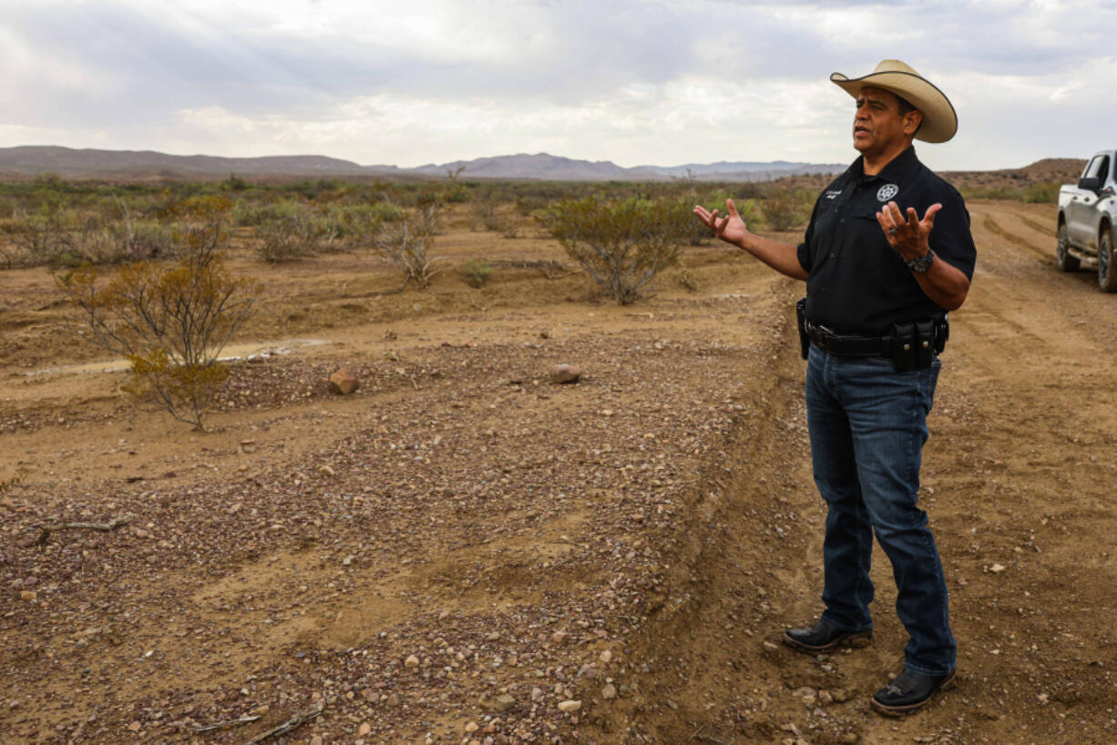 Culberson County Sheriff Oscar Carrillo stands by the spot where the body of 15-year-old boy Christian was found on Thursday, June 24, 2021. Carrillo says they received a distress call from a rancher using a satellite phone on June 21st. The rancher said he had found two migrants in the desert of Texas on Chispa Road in Jeff Davis County. Raul, 35, and his son Christian, 15, both from Ecuador, were crossing the border from Mexico to the U.S. when they got lost after their smuggler abandoned them. Upon deputies' arrival to the scene, Raul was showing signs of severe dehydration, but his son Christian was already deceased.
