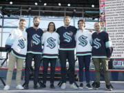 Seattle Kraken NHL hockey players Jordan Eberle, Chris Dreidger, Brandon Tanev, Jamie Oleksiak, Hadyn Fluery and Mark Giordano, from left, pose for a photo Wednesday, July 21, 2021, after being introduced during the Kraken's expansion draft event in Seattle. (AP Photo/Ted S.