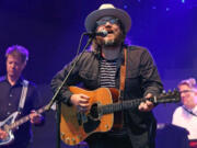 Wilco's Nels Cline, from left, Jeff Tweedy and Mikael Jorgensen perform at Pritzker Pavilion in Millennium Park in Chicago in 2016.