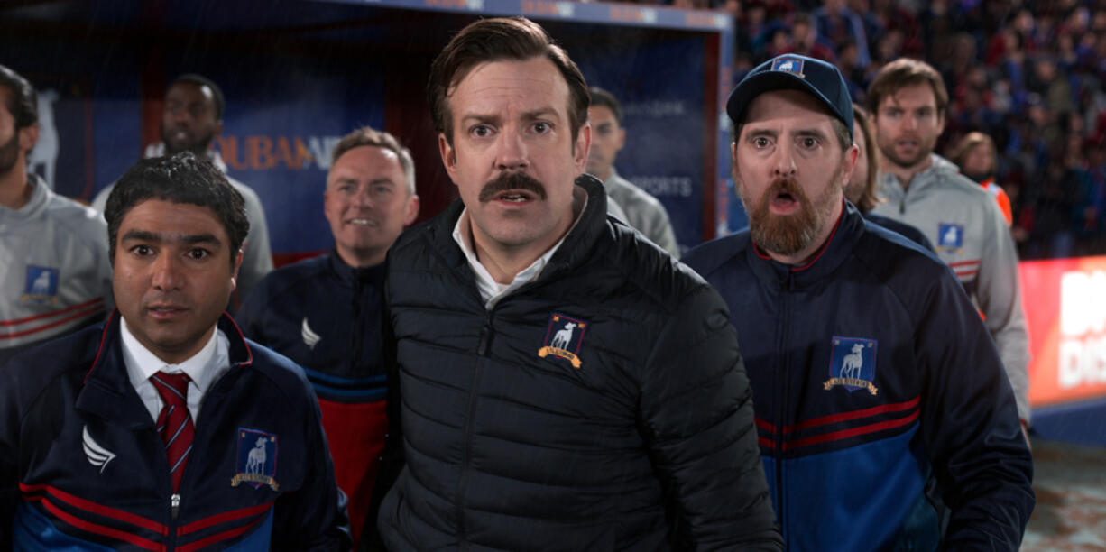 """You may be shocked to learn that Jason Sudeikis, center, envisions only three seasons for """"Ted Lasso."""" Season two debuts today. He stars with Nick Mohammed, left, and Brendan Hunt."""