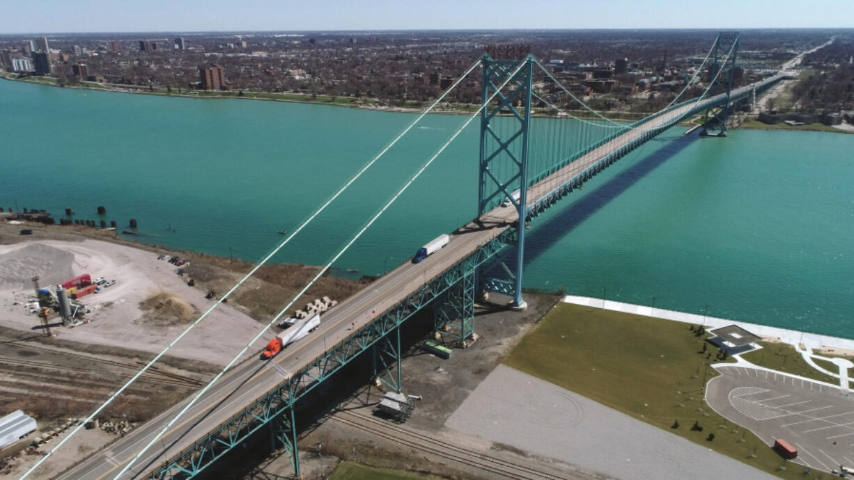 Travel is still restricted between the United States and Canada but that will be changing soon. A drone photo shows the Ambassador Bridge, which connects the U.S. to Canada, is virtually empty except for trucking traffic on April 2, 2020.
