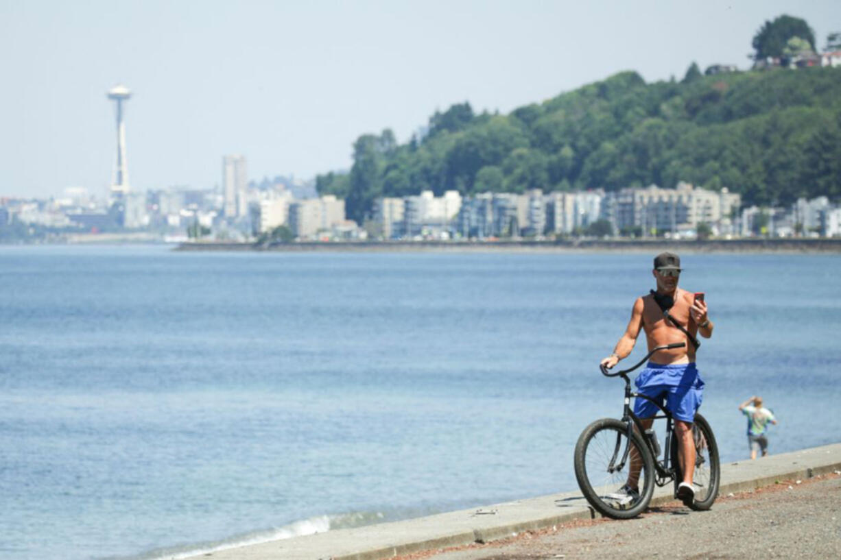 A bike rider is pictured as an excessive heat warning remains in effect a day after record-breaking temperatures from a historic heatwave throughout the region in Seattle, Washington on June 29, 2021.