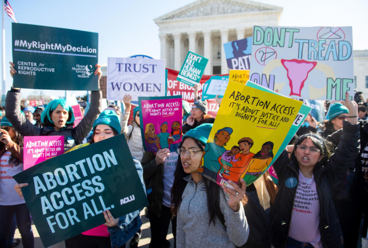 Pro-choice activists supporting legal access to abortion protest during a demonstration outside the U.S. Supreme Court in Washington, D.C., March 4, 2020.