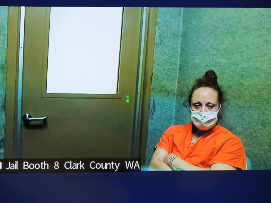 Misty Raya, 35, makes a first appearance Monday morning in Clark County Superior Court on a warrant in a June burglary case. Clark County Prosecutor Tony Golik said the weapon used to fatally shoot sheriff's Detective Jeremy Brown was one of 27 stolen in the burglary.