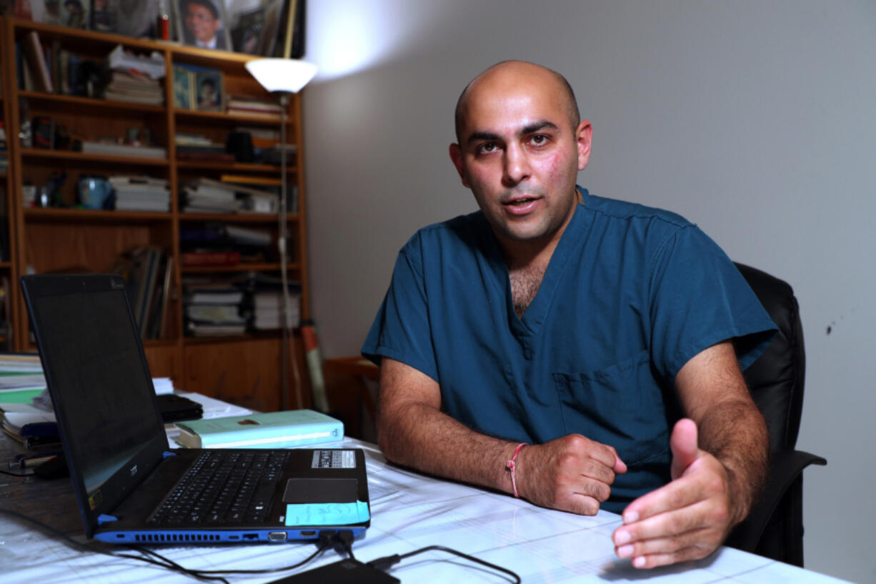Jay K. Joshi is seen at home on Thursday, July 15, 2021. He served 11 months in federal prison after pleading guilty to prescribing controlled substances without a legitimate medical purpose. He says his guilty plea was a mistake, and that his prosecution was the product of government hysteria over opioid painkillers.