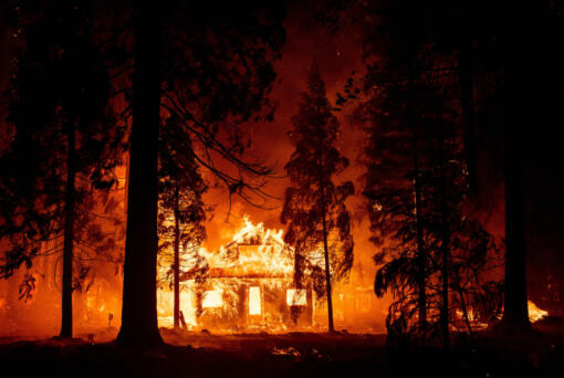 A home burns as flames from the Dixie fire tear through the Indian Falls neighborhood of unincorporated Plumas County, California, on Saturday, July 24, 2021.