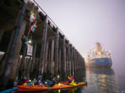 Protesters with the activist groups Mosquito Fleet and Portland Rising Tide attempted to block a ship from docking at the Port of Vancouver to offload oil pipe supplies on Nov. 5, 2019. Criminal charges against four of the climate activists have been dropped.