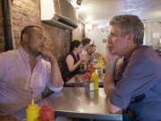 """David Chang, left, and Anthony Bourdain in Morgan Neville's new documentary, """"Roadrunner."""" (Contributed by Focus Features, in association with Zero Point Zero)"""
