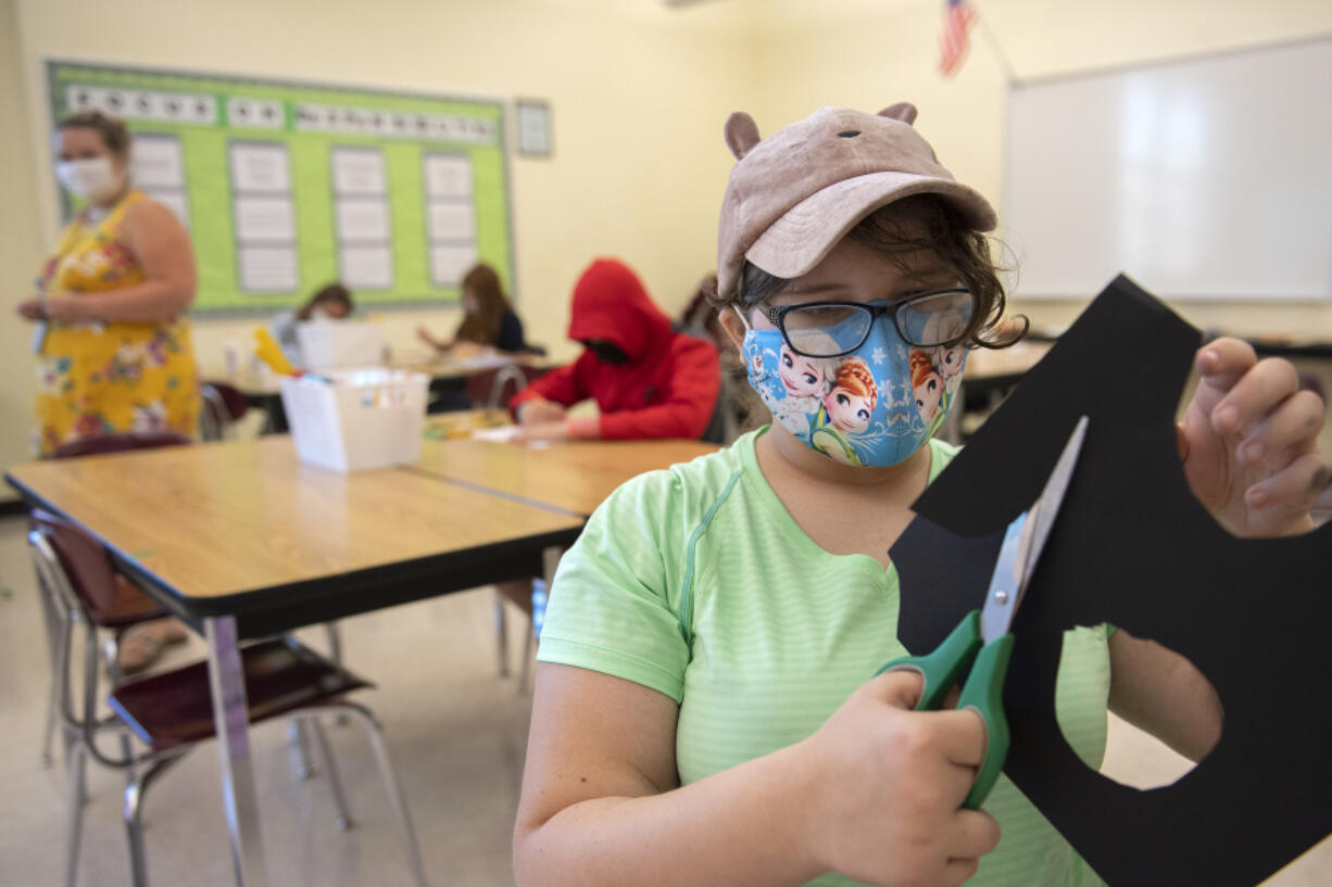 Maddie Ackerman, 13, tackles a project during a summer school art class at Covington Middle School on Tuesday morning. Evergreen Public Schools is expanding summer school offerings to middle school students for the first time, in subjects ranging from algebra readiness to science, plus a host of Social Emotional Learning options.