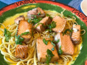 This is summer chinook in a white wine, garlic, fresh basil, olive oil sauce over fettuccine.