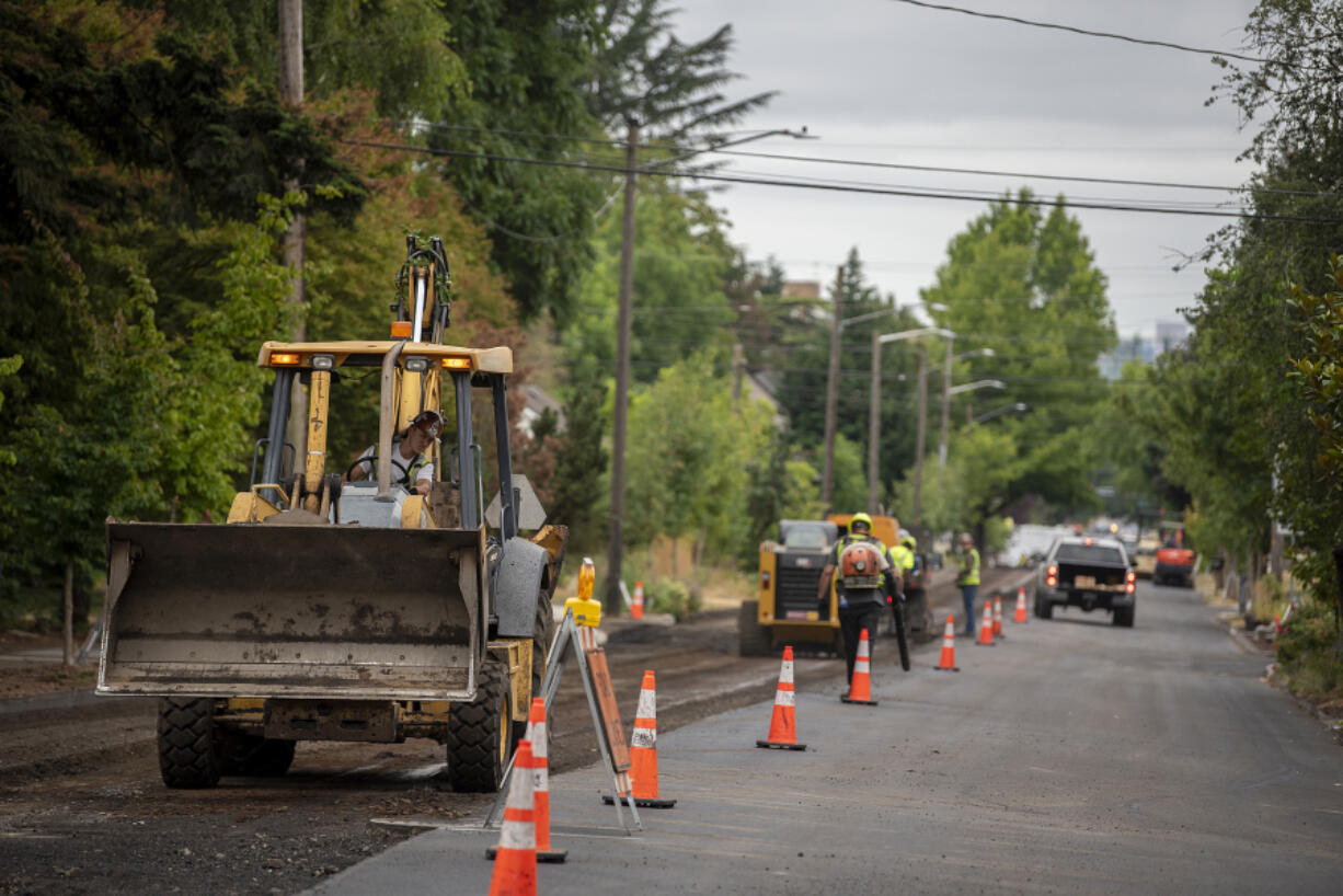 Street paving in preparation for the new bike lane striping project is underway along Columbia Street near the intersection of 33rd Street on Wednesday morning. The contractor, Granite Construction, expects to wrap up the first phase of the work in mid-July.