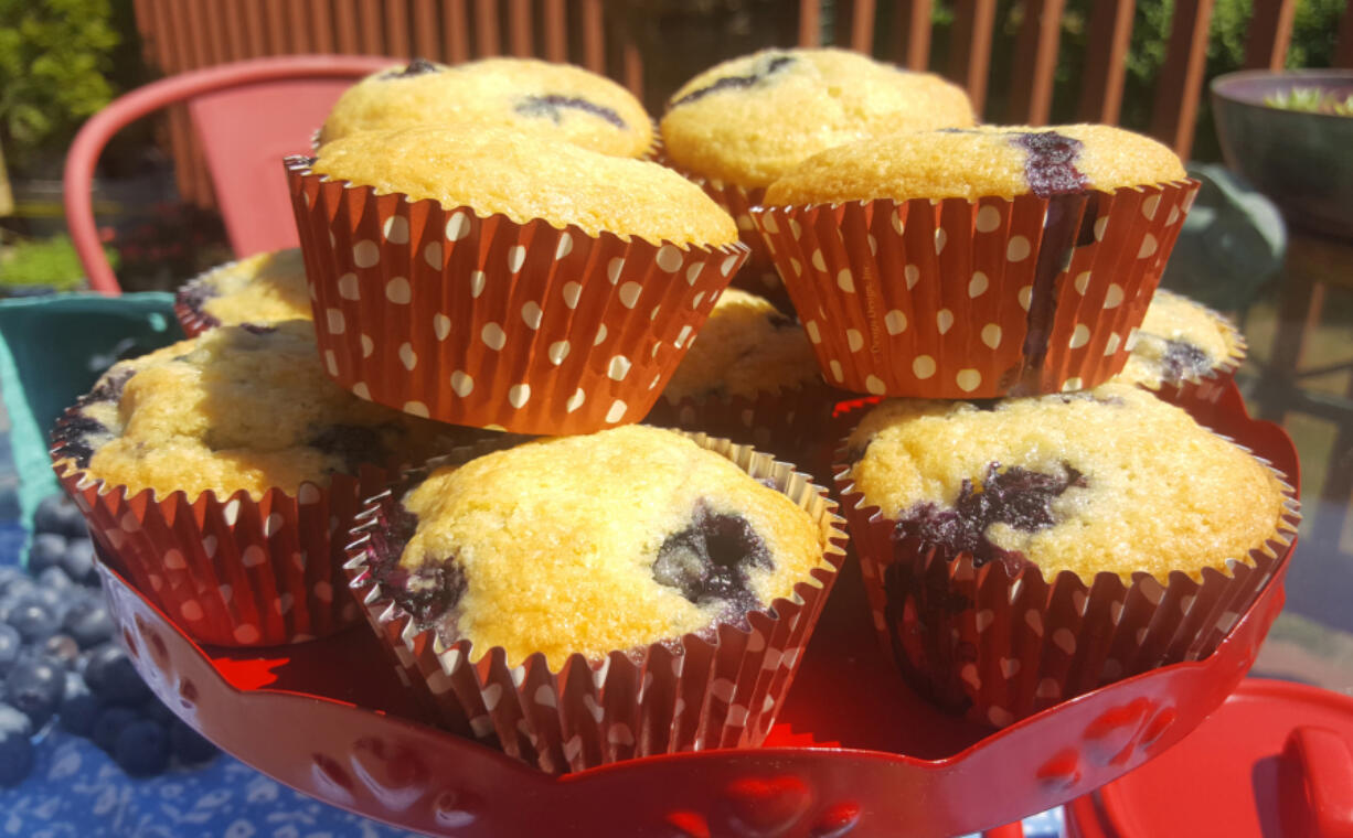 These blueberry muffins bake up nice and moist, bursting with blueberries.