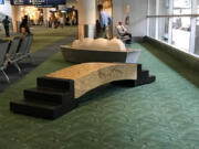 VANCOUVER: A bridge, seen in the foreground, and a boat in the background, both made of Indian granite and Italian marble by artist Larry Kirkland, will be moved from their longtime home at the Portland International Airport later this summer.