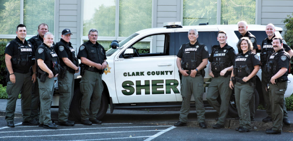 FAIRGROUNDS: Eleven of 14 members of the Clark County Sheriff's Office Reserve Deputies unit gathered for a photo at their final meeting on June 28.