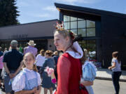 A cast of book characters helped celebrate Friday's grand opening of the new Ridgefield Community Library, including 10-year-old Iris Taylor dressed as Dorothy from the Wizard of Oz, and her sister, Guinevere Taylor, 14, dressed as the Queen of Hearts. About 500 attended the opening of the nearly 8,000-square-foot library at 210 Main Ave. in Ridgefield.