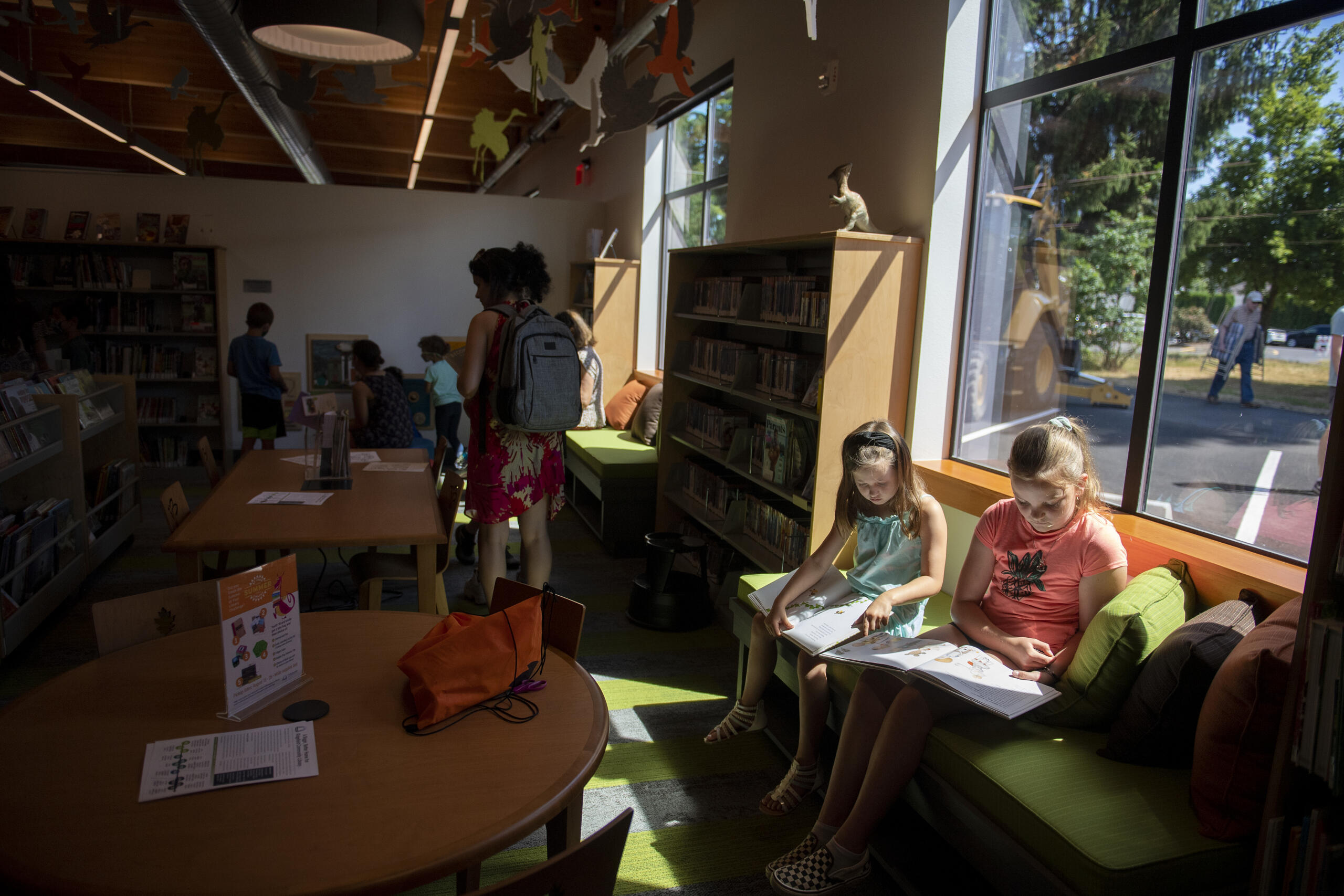 Cousins Lizzy Mire, 8, in blue, and Juel Natterstad, 10, cq, both of Ridgefield, enjoy a good book in the children's section at Ridgefield Community Library on Friday morning, July 9, 2021.