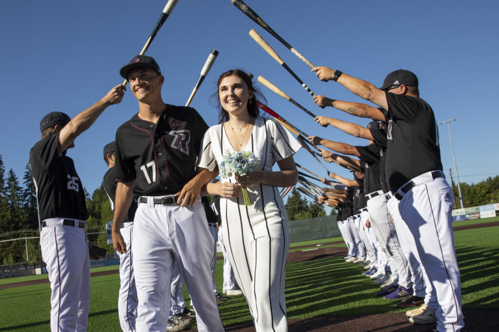 Eli Shubert, pitcher for the Ridgefield Raptors, marries Erin Thum in a short ceremony on the field before a game against the Port Angeles Lefties at Ridgefield Outdoor Recreation Complex on Wednesday, July 14, 2021.