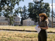 Joshua Hart/The Columbian   National Park Service curator Meagan Huff points toward the East Barracks on a July 17 walking tour discussing its history in the 1880s.