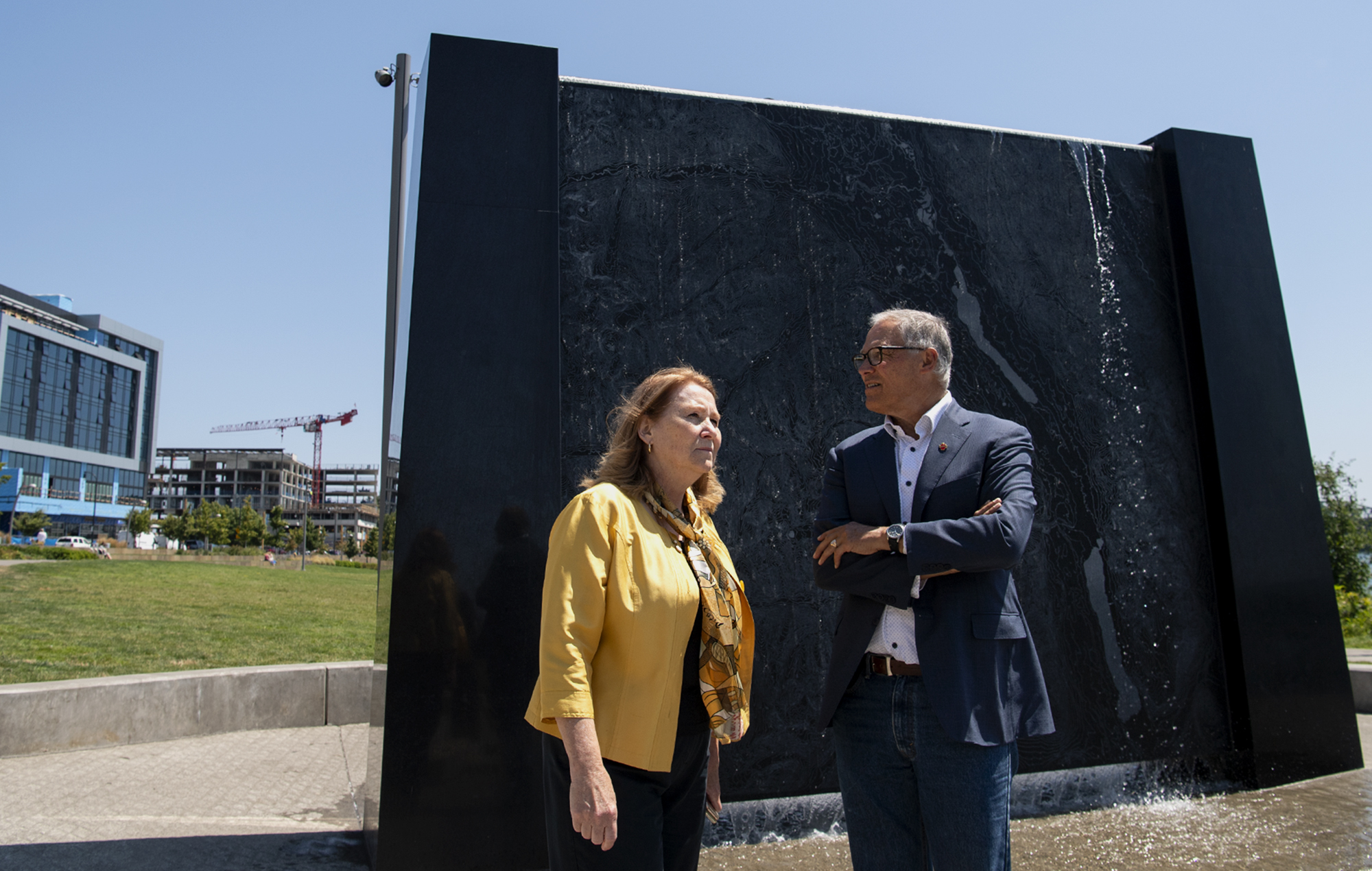 Vancouver mayor Anne McEnerny-Ogle and Washington governor Jay Inslee survey the Vancouver Waterfront while standing in front of an interactive sculpture that depicts the topography of the Columbia River on Tuesday, July 13, 2021, in Vancouver. Inslee toured the waterfront with Vancouver mayor Anne McEnerny-Ogle before meeting with local small business owners.