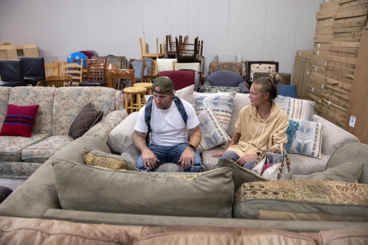Client Jeramy Bracken shops for apartment furniture with Connie McGarry at NW Furniture Bank. As an Army veteran, Bracken qualifies to take part in the program.