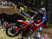 Chase Sexton adds some flair to the jump at Turn 18 on his way to victory in the 450 class Moto 1 at the Washougal National on Saturday, July 24, 2021 at Washougal MX Park. Chase Sexton won the 450 class and Jeremy Martin was victor of the 250 class in the seventh round of the Lucas Oil Pro Motocross Championships.